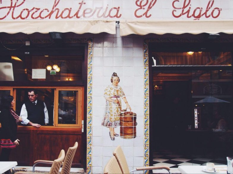 A waiter stands in the service widow of a horchata bar in Valencia.