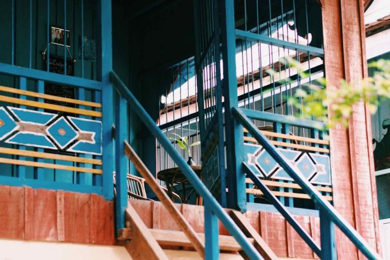 A blue and wooden balcony at Cambodian Weaving Village.