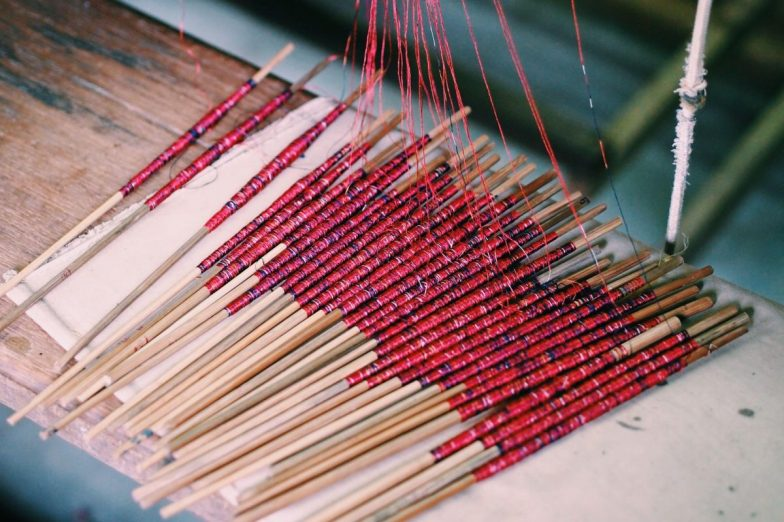 Ikat dyed threads ready for weaving at the Angkor Silk Farm.