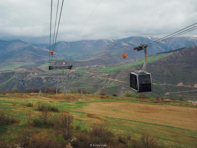 A ropeway over a green valley in Armenia.