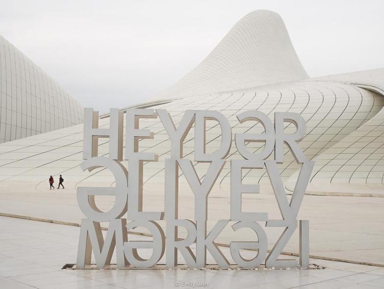 A sign reads 'Heydar Aliyev Center' in Azeri language.