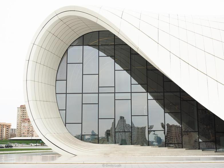 A curved building with reflective windows.