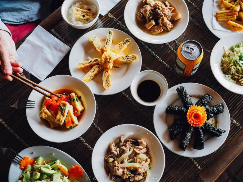 A spread of food on a bamboo table.