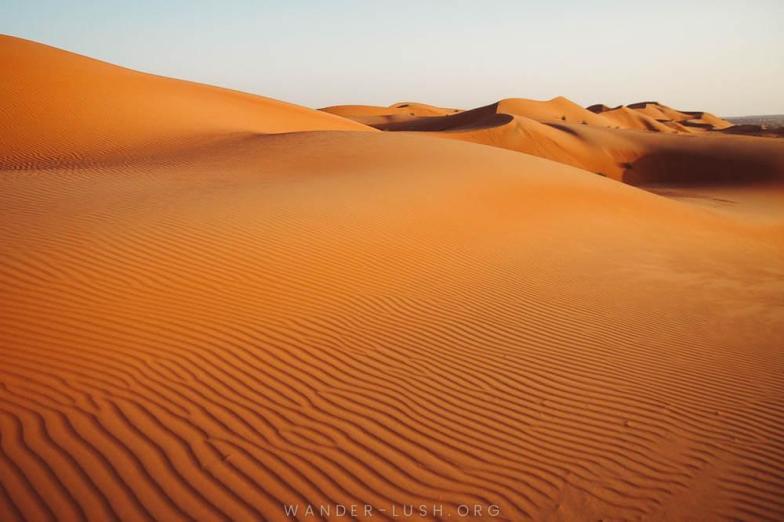 Rippled dunes in Oman's Wahiba Sands desert. Photo credit: Copyright Emily Lush | Oman road trip