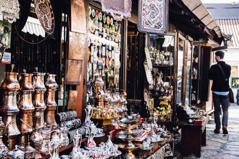 A market filled with bronze and copper pots.