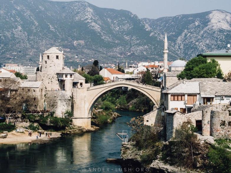 A stone bridge over a blue river in Mostar.