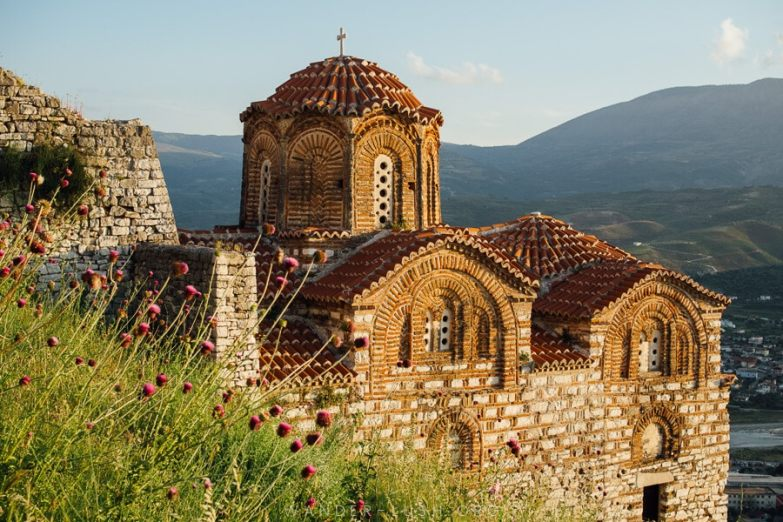 The Church of St Trinity bathed in golden light, one of the best things to do in Berat.