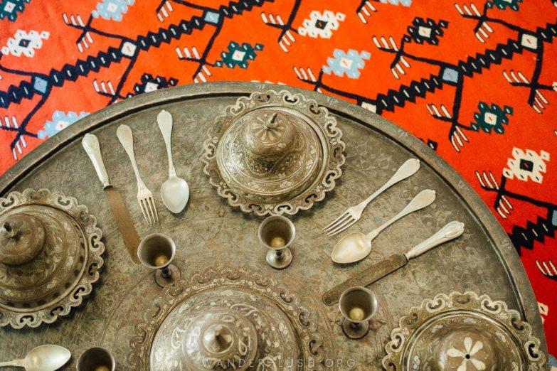 Silverware set against an Ottoman-style carpet.