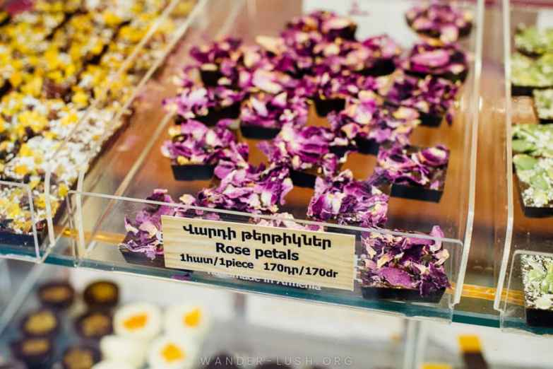 Chocolate topped with rose petals.