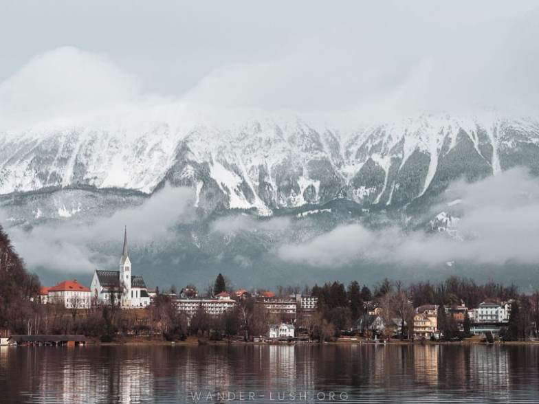 Snow-capped mountains and a pretty lake in Slovenia.