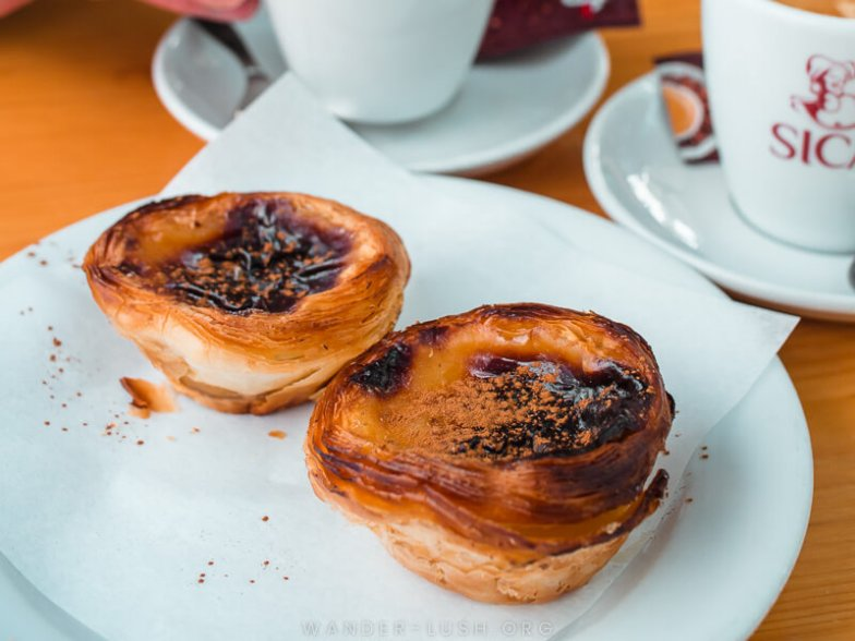 Two custard tarts at a cafe in Lisbon.