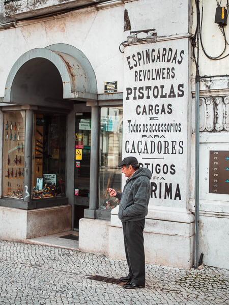 A man on the street in Lisbon.