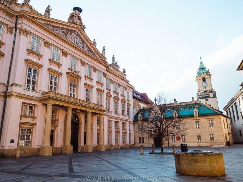 A pink classical facade in Bratislava.