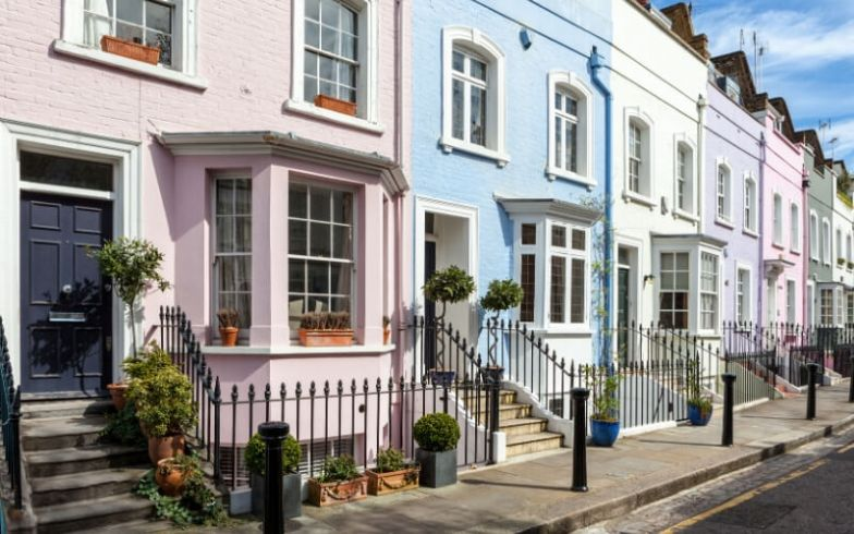 A row of pastel-coloured houses in London.