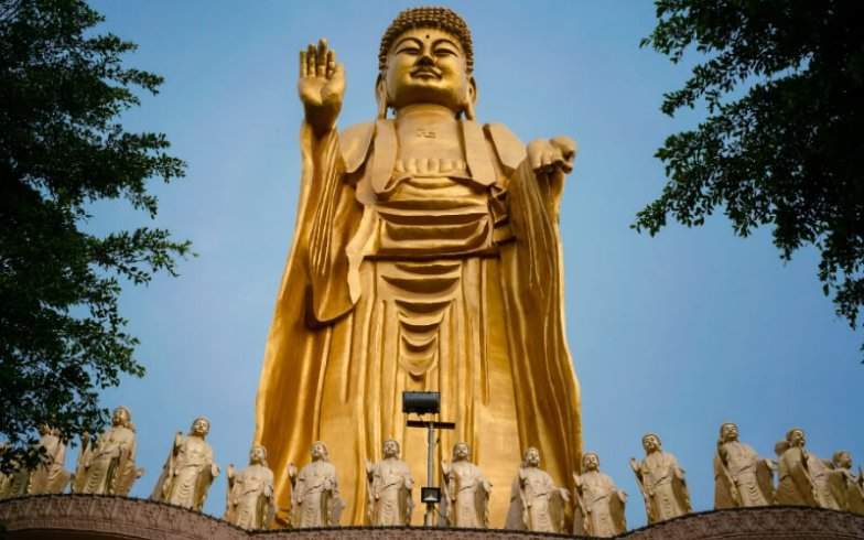A huge bronze-coloured Buddha statue in Kaohsiung, Taiwan.
