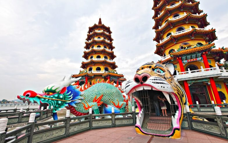 Temples and two statues resembling a dragon and tiger in Kaohsiung, Taiwan.