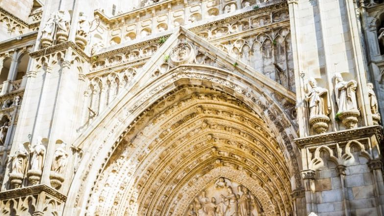 The stone facade of the cathedral in Toledo, Spain.