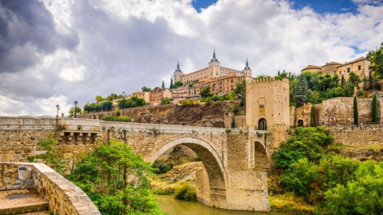 Stone buildings and a bridge in Toledo, Spain.