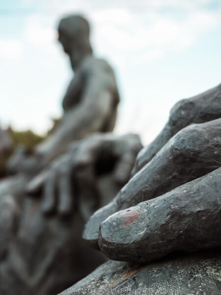 Close-up on the hand of a sculpture.