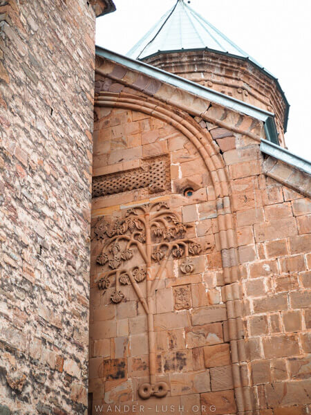 A stone church with a beautiful engraving.