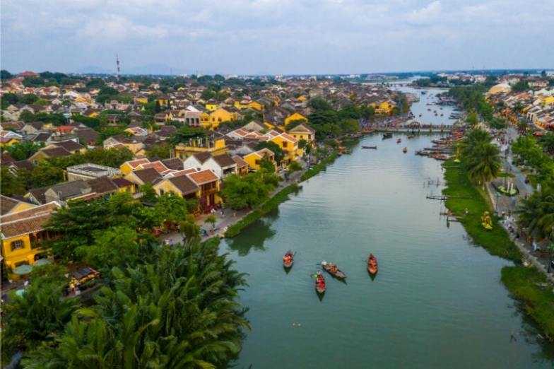 Hoi An town in Vietnam, with its yellow buildings and blue river.