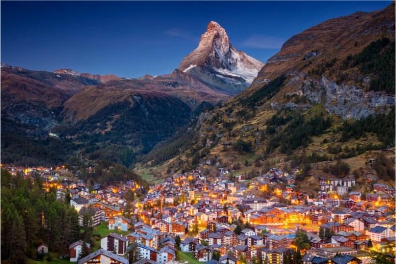 The Matterhorn above the city of Zermatt at night.