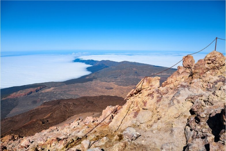 View of the clouds from the top of a rocky peak in Spain.