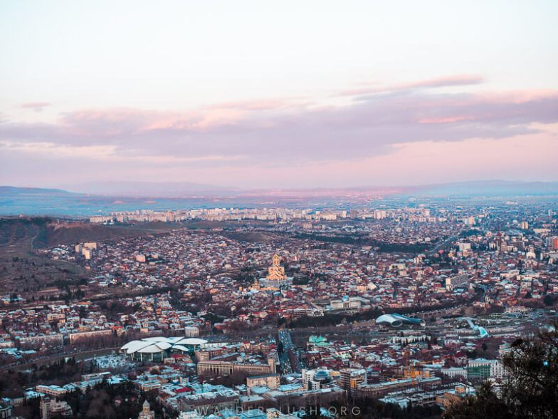 A view of Tbilisi city at dusk.