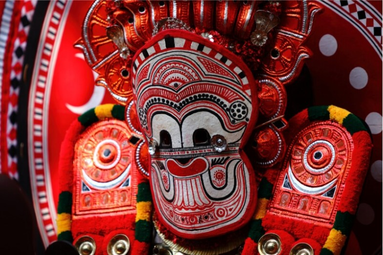 A colourful festival mask worn as part of a Kerala culture ritual.