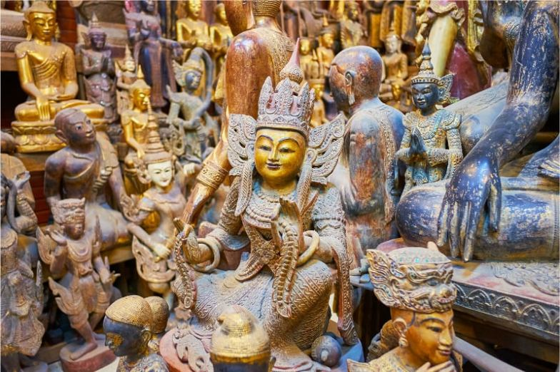 Wooden carvings and statues inside a craft workshop in Myanmar.