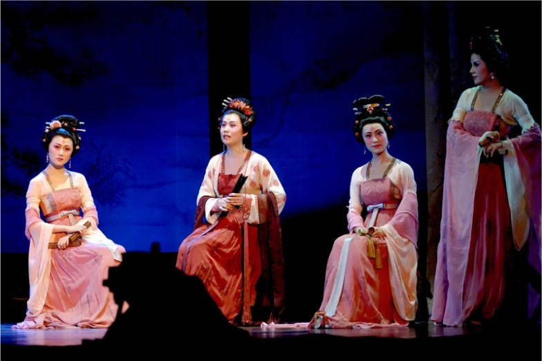 Four women on a stage perform Nanyin, part of traditional Chinese-Singaporean culture.