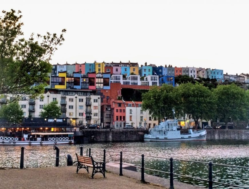 A photo of the Bristol harbourside with some colourful houses in the background