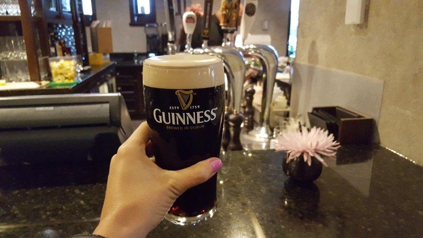 Holding my Guinness in Dublin, Ireland