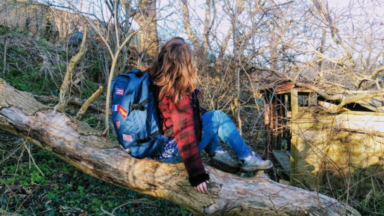 Justine modelling the CabinZero bag on a hike in the woods