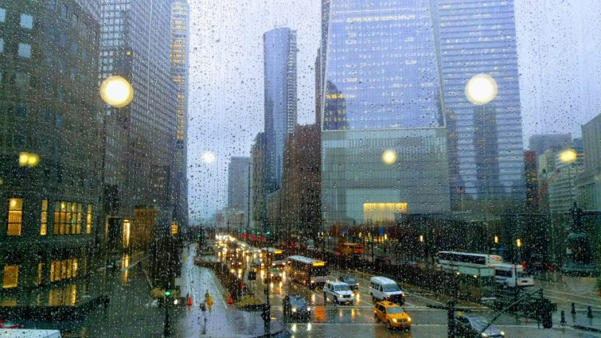 A glimpse of the streets of New York from behind a rain spattered window