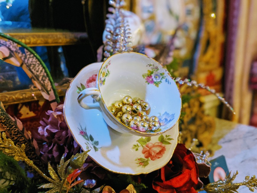A close up of tea cups in flower arrangements at Blenheim Palace