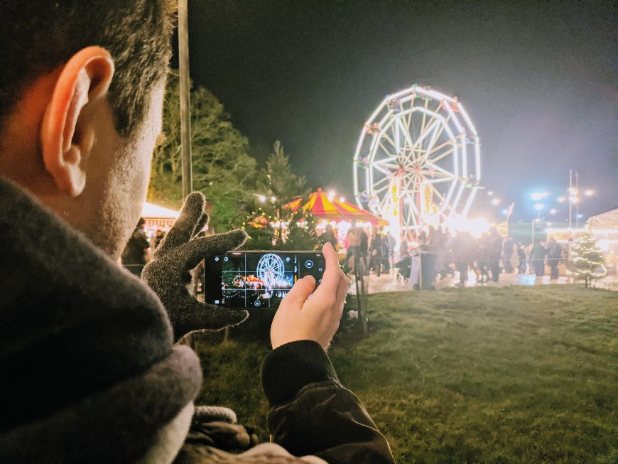 Scott taking a photo of the Christmas Village at Westonbirt Arboretum