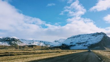 Empty roads in Iceland with mountains in the background