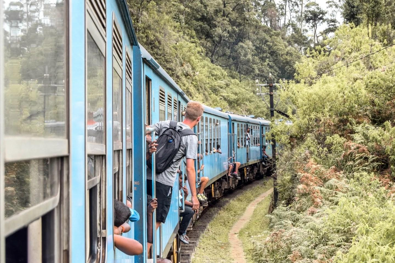 Wanderers & Warriors - Charlie & Lauren UK Travel Couple - Kandy To Ella Train Sri Lanka - Hanging out of the train
