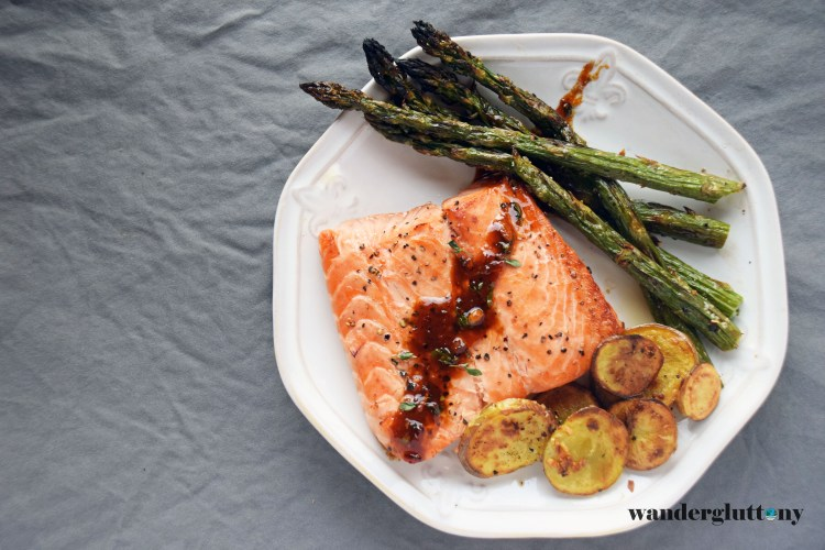A simple and elegant dinner perfect for a back patio date. Using fresh local ingredients, I whipped together this Napa Chardonnay Broiled Salmon with Roasted Asparagus and Heirloom Fingerling Potatoes. Simple and delicious paired beautifully with a big glass of wine! #foodie #recipe #wine #dinnerdate #cooklocal #seasonal