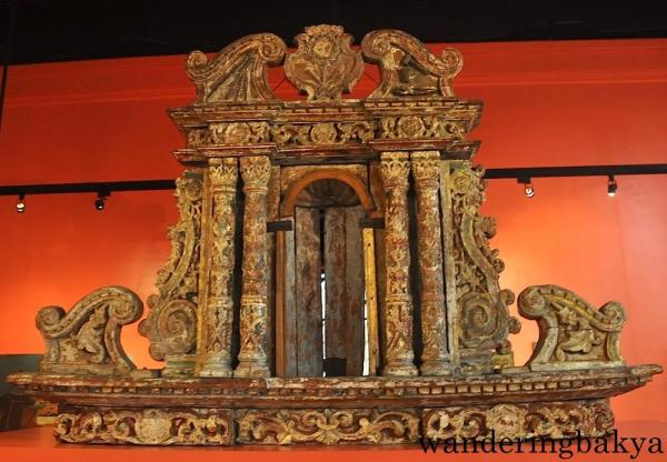 Retablo, smaller one opposite the one on top (Side Altar) of Church of San Nicolas de Tolentino, Dimiao, Bohol by an unknown artist (Wood)