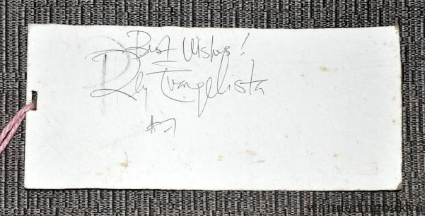 Rey Evangelista autograph. His pen ran out of ink so I offered him my own pen, which I cannot find as of this writing.