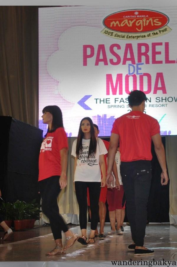 The models wearing Caritas Manila shirts