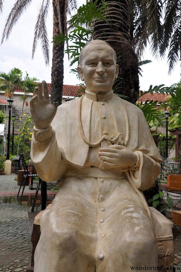 Pope John Paul II. Visitors of Barasoain Church can sit beside a saint and have small talk with him.