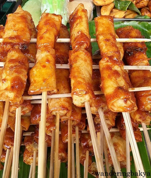 Turon (banana wrapped in lumpia wrapper coated with brown sugar), P12.00 (US $0.27) per stick.