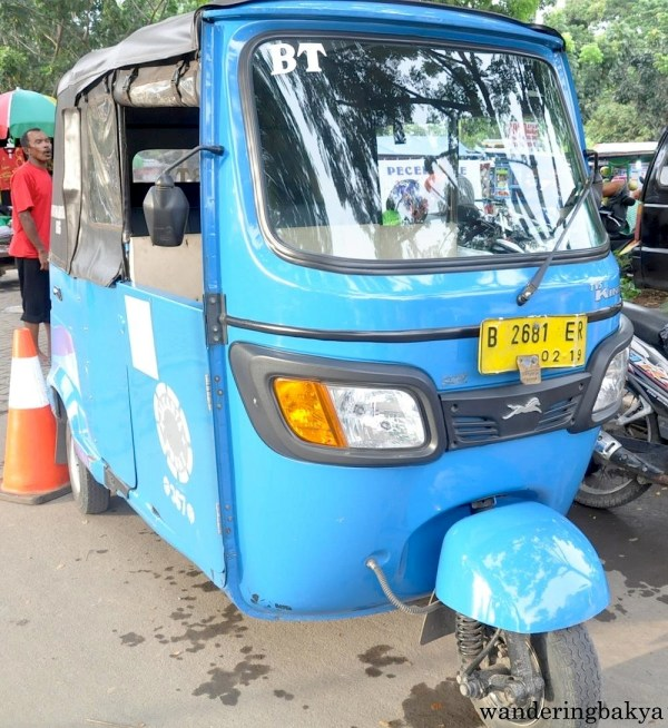 Bajaj or bajay, Indonesia's version of Tuktuk. The bajaj are color coded to represent the particular area in Jakarta that they service. They are not allowed on major roads.