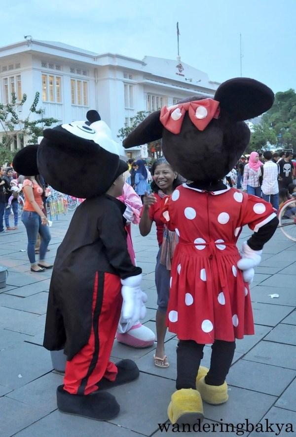 Doraemon : Merdeka Square :: Mickey mouse and Minnie Mouse : Old Batavia