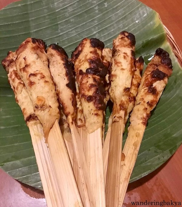 I do not know the name of this dish, but it is like chicken fillet, sprinkled with spices, wrapped around a flat stick, and grilled to perfection.