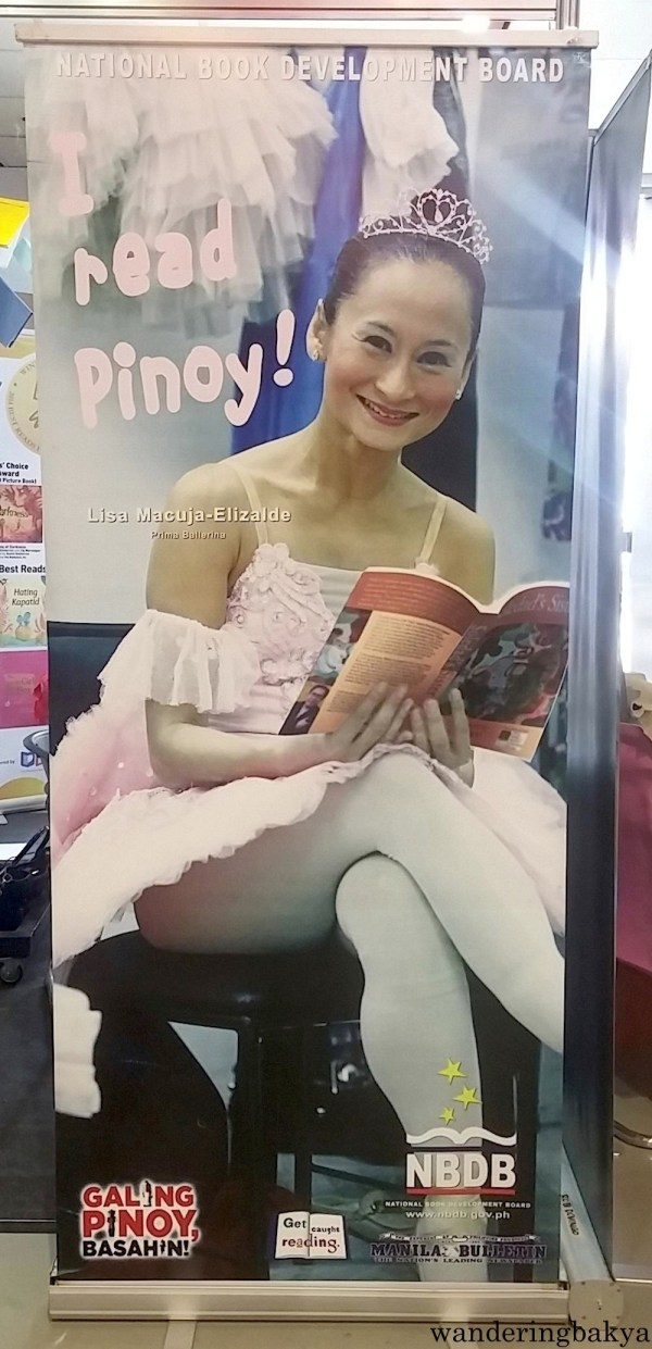 A tarpaulin with Lisa Macuja-Elizalde's image encouraging Filipinos to read was situated near one of the doors.