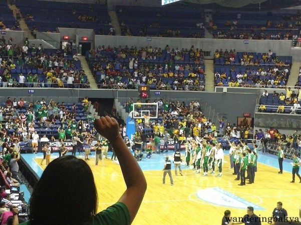 The Green Archers faced their fans as they sang their school anthem.